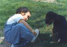 Anton showing off his new shoes to some puppy, 1972