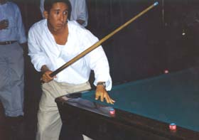 Shooting pool at the rehearsal dinner outing